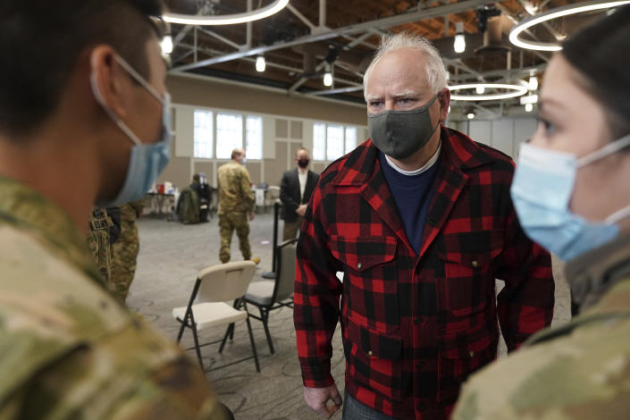 Gov. Tim Walz talked with members of the National Guard who were helping manage the people there for appointments to get a COVID-19 vaccine Thursday, Jan. 28, 2021 at the Earle Brown Heritage Center in Brooklyn Center. (Anthony Souffle/Star Tribune via AP)