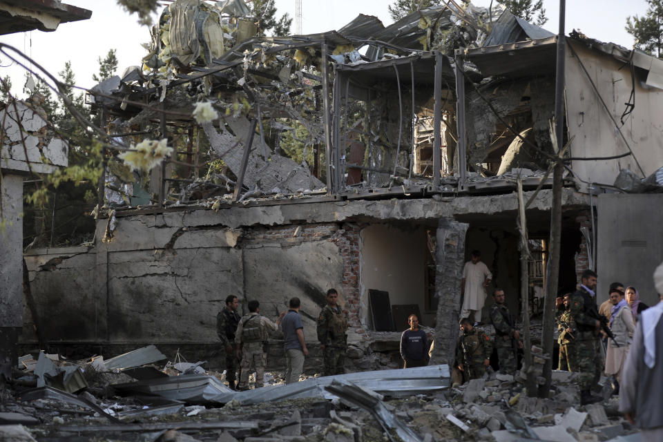 Afghan security personnel inspect the house of acting defense minister following an attack in Kabul, Afghanistan, Wednesday, Aug. 4, 2021. A powerful explosion rocked an upscale neighborhood of Afghanistan's capital Tuesday in an attack that apparently targeted the country's acting defense minister. (AP Photo/Rahmat Gul)