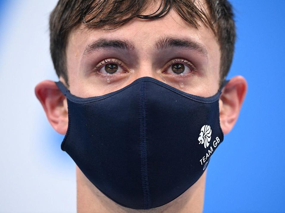 Britain's Thomas Daley and Britain's Matty Lee (unseen) as they wait to receive their medals after wining the men's synchronised 10m platform diving final event during the Tokyo 2020 Olympic Games at the Tokyo Aquatics Centre
