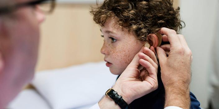 child being fitted for a hearing aid
