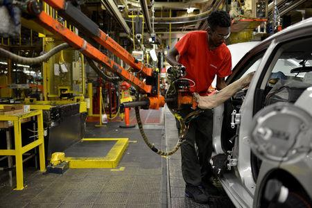 FILE PHOTO: A line worker installs the front seats on the flex line at Nissan Motor Co's automobile manufacturing plant in Smyrna, Tennessee, U.S., August 23, 2018. REUTERS/William DeShazer/File Photo