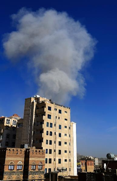 Smoke billows over the rebel-held Yemeni capital Sanaa after an air strike hit the city centre (AFP Photo/Mohammed HUWAIS)