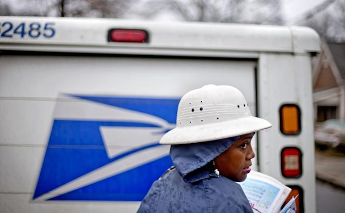"The U.S. Postal Service's reliability looms large as the election nears and many states plan to conduct most voting by mail. <span class=""copyright"">(David Goldman / Associated Press)</span>"
