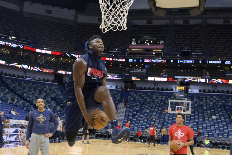 New Orleans Pelicans forward Zion Williamson goes to the basket before the start of an NBA basketball game against the Chicago Bulls in New Orleans, Wednesday, Jan. 8, 2020. Williamson is not scheduled to play. (AP Photo/Matthew Hinton)