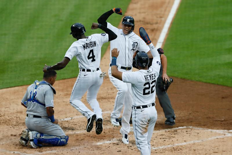 Detroit Tigers' JaCoby Jones, center, is greeted at home plate by teammates Cameron Maybin (4) and Victor Reyes (22) after hitting a three-run home run during the second inning of a baseball game against The Kansas City Royals, Monday, July 27, 2020, in Detroit.