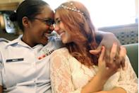 <p>U.S. Air Force Senior Airman Shyla Smith (left) and love Courtney Burdeshaw laugh while waiting to get married at the Manhattan Marriage Bureau the day after the U.S. Supreme Court's ruling on DOMA. The high court struck down the Defense of Marriage Act and ruled that supporters of California's ban on gay marriage, Proposition 8, could not defend it before the Supreme Court.</p>