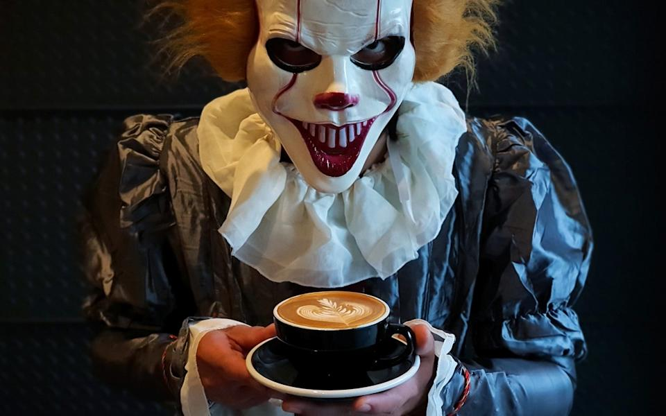 A barista dressed in a Pennywise clown halloween costume is pictured at a coffee shop in Nonthaburi province ,Thailand - CHALINEE THIRASUPA / REUTERS