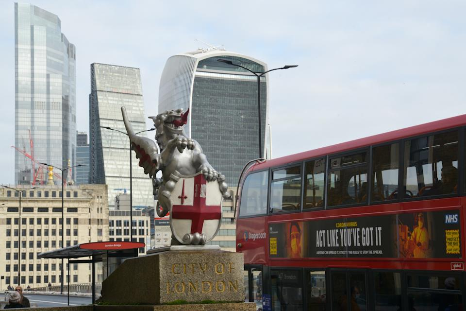 "LONDON, UNITED KINGDOM - 2021/02/02: A bus with a sign saying ""Act Like You've Got It"" passing by the City of London financial district. (Photo by Thomas Krych/SOPA Images/LightRocket via Getty Images)"