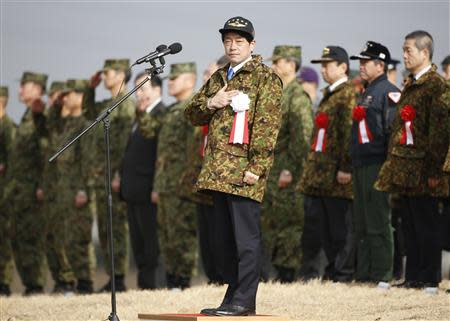 Japan's Defence Minister Onodera reviews troops from the Japanese Ground Self-Defense Force 1st Airborne Brigade during an annual new year military exercise in Funabashi