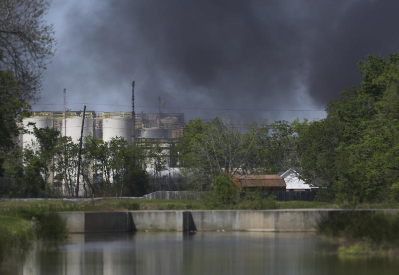A plume of smoke rises over the site of a fire at the KMCO plant Tuesday, April 2, 2019, in Crosby, northeast of Houston, Texas. A tank holding a flammable chemical caught fire at the Texas plant Tuesday. Harris County Sheriff Ed Gonzalez confirmed fatality in a tweet and said injured ones had been taken by helicopter to a hospital. (Godofredo A. Vasquez/Houston Chronicle via AP)