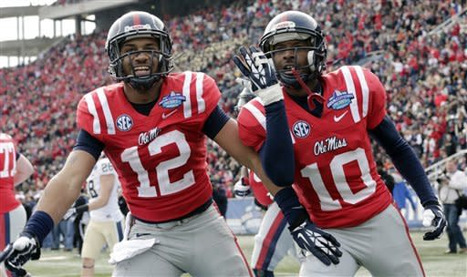 Mississippi wide receiver Vince Sanders (10) celebrates with teammate Donte Moncrief (12) after scoring a touchdown against Pittsburgh during the first half of the BBVA Compass Bowl NCAA college football game at Legion Field in Birmingham, Saturday, Jan. 5, 2013. (AP Photo/Dave Martin)