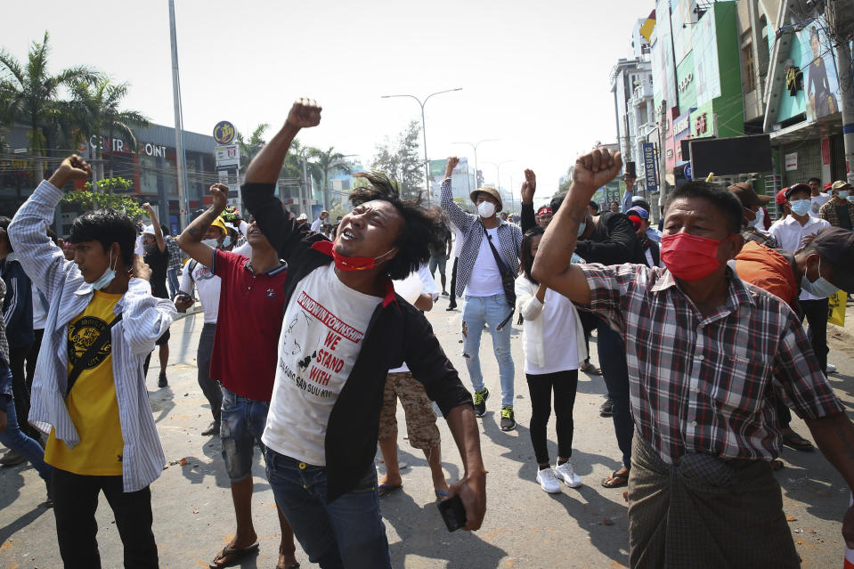 Protesters shout slogans during a protest against the military coup in Mandalay, Myanmar, Sunday, Feb. 28, 2021. Police fired tear gas and water cannons and there were reports of gunfire Sunday in Myanmar's largest city Yangon where another anti-coup protest was underway with scores of students and other demonstrators hauled away in police trucks. (AP Photo)