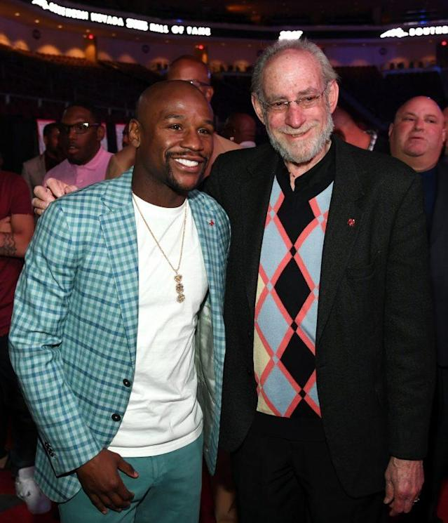 Floyd Mayweather (L) poses with UFC vice president Marc Ratner on June 2 in Las Vegas after being inducted into the Southern Nevada Sports Hall of Fame. (Getty Images)