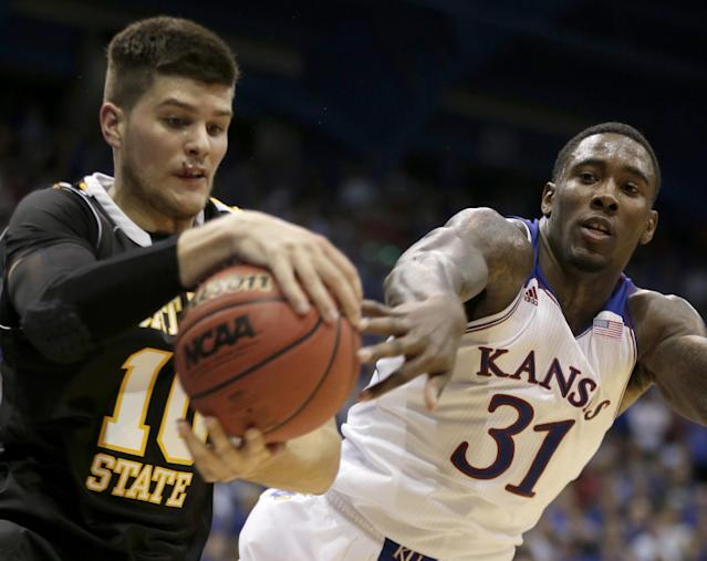 Kansas' Jamari Traylor (31) tries to steal the ball from Fort Hays State's Jared Tadlock during the first half of an exhibition NCAA college basketball game Tuesday, Nov. 5, 2013, in Lawrence, Kan. (AP Photo/Charlie Riedel)