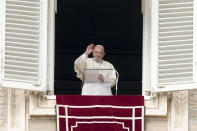 Pope Francis waves as he leaves after the Angelus noon prayer from the window of his studio overlooking St.Peter's Square, at the Vatican, Sunday, Oct. 3, 2021. (AP Photo/Alessandra Tarantino)