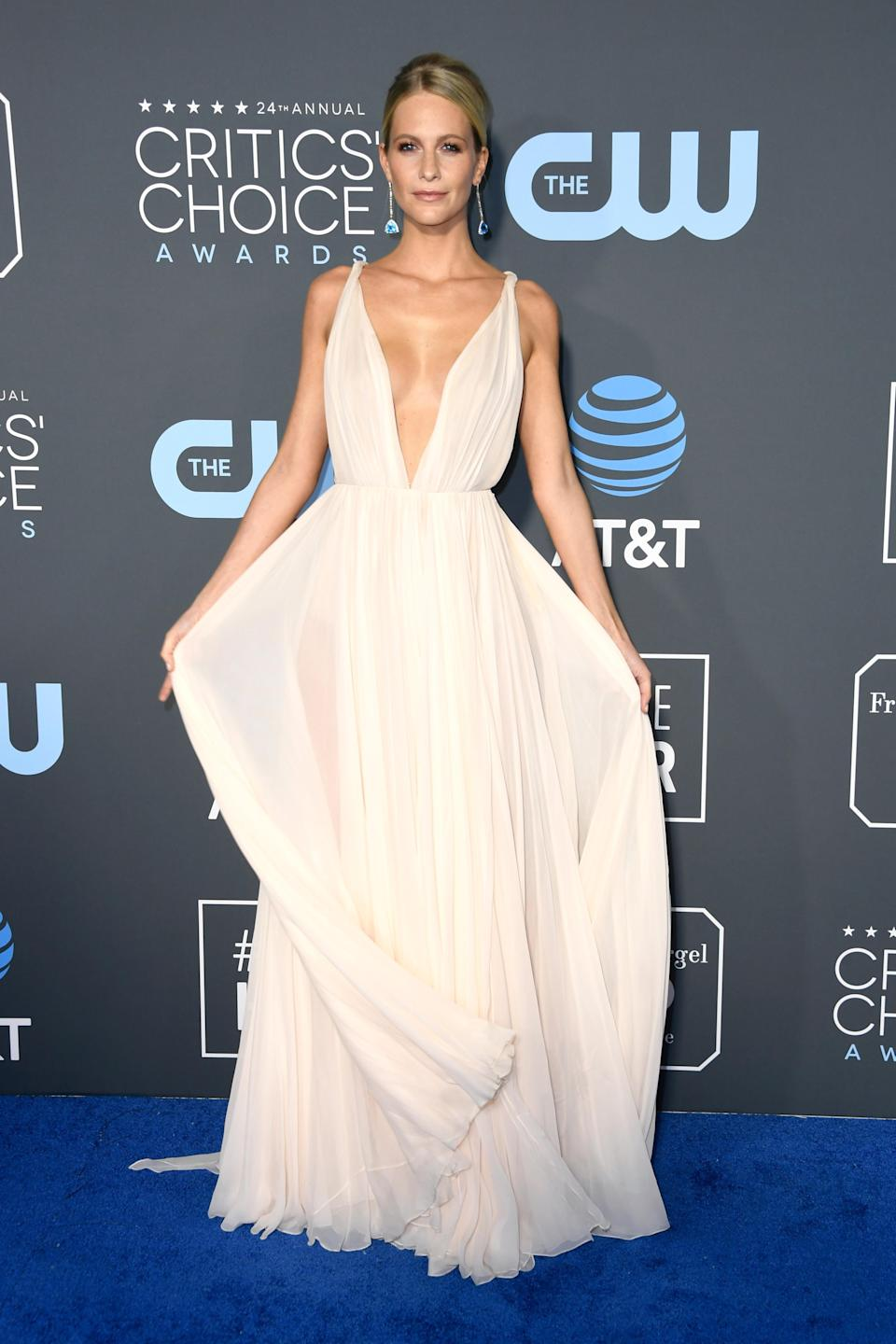 <p>Model Poppy Delevingne stunned in an ethereal gown with a plunging neckline. Source: Getty </p>