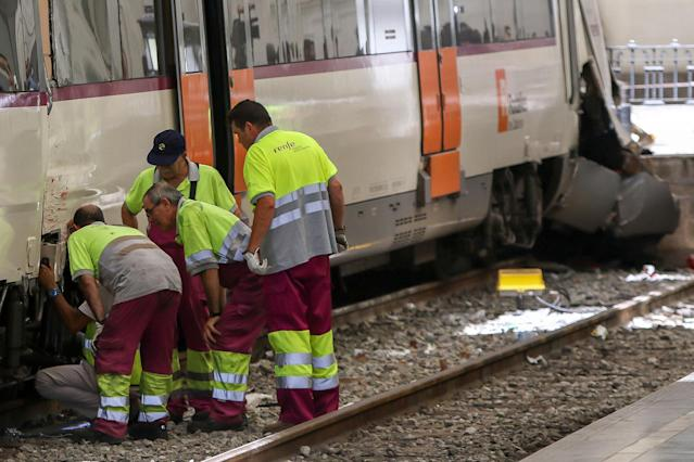 <p>Railway technicians check a train wagon at the Estacio de Franca (Franca station) in central Barcelona on July 28, 2017 after a regional train appears to have hit the end of the track inside the station injuring dozens of people. (Photo: Miquel Llop/NurPhoto via Getty Images) </p>