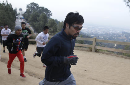 Manny Pacquiao runs along a trail at Griffith Park in Los Angeles. (AP)