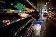 Empty shelves in Australia's Brisbane after a single new case sparked panic-buying