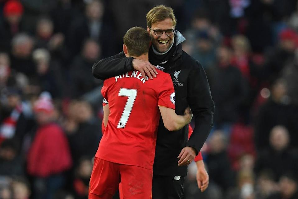 Liverpool's manager Jurgen Klopp (R) embraces midfielder James Milner after their English Premier League match against Burnley, at Anfield in Liverpool, on March 12, 2017 (AFP Photo/Paul Ellis)