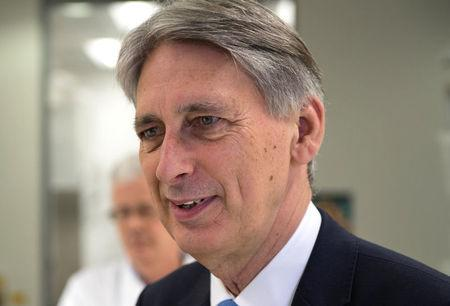 UK Chancellor Urged To Revise His Target Date For Eliminating Deficit
