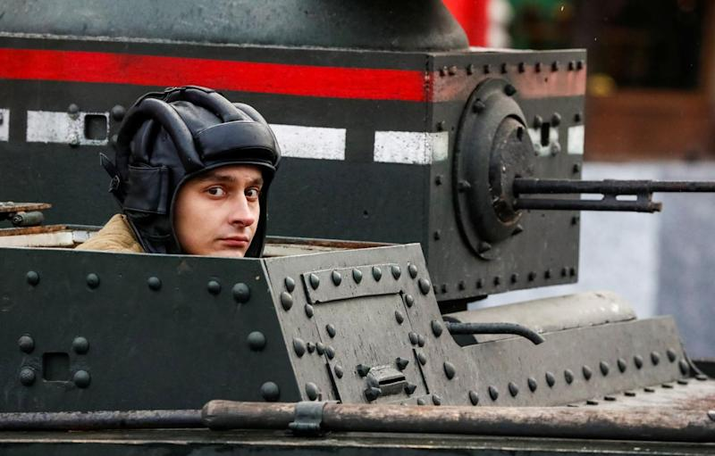A Russian Army member rides in a historical tank, during a rehearsal for a military parade to mark the anniversary of a historical parade in 1941, when Soviet soldiers marched towards the front lines at the Red Square in Moscow, Russia November 5, 2017. R