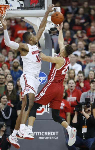 Wisconsin guard Kobe King, right, goes up to shoot in front of Ohio State forward Kaleb Wesson during the second half of an NCAA college basketball game in Columbus, Ohio, Friday, Jan. 3, 2020. (AP Photo/Paul Vernon)