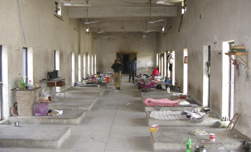"""Pakistani police officers examine the main hall of a central jail in Bannu, 170 kilometer (106 miles) south of Peshawar, Pakistan on Sunday, April 15, 2012. Taliban militants battled their way into the prison in northwest Pakistan on Sunday, freeing close to 400 prisoners, including at least 20 described by police as """"very dangerous"""" insurgents, authorities and the militants said. (AP Photo Ijaz Muhammad)"""