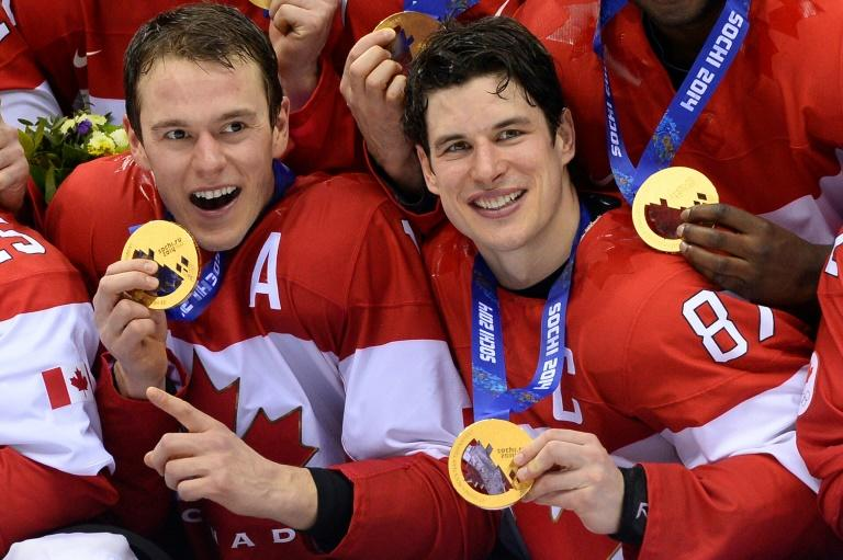Canada's gold medallists Jonathan Toews (left) and Sidney Crosby pose during the Men's Ice Hockey Medal Ceremony during the Sochi Winter Olympics on February 23, 2014