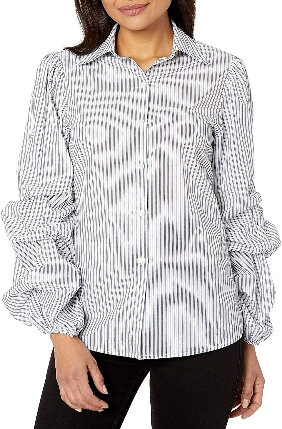 <p><span>Lark & Ro Woven Shirt With Pintucked Sleeve</span> ($23)</p>