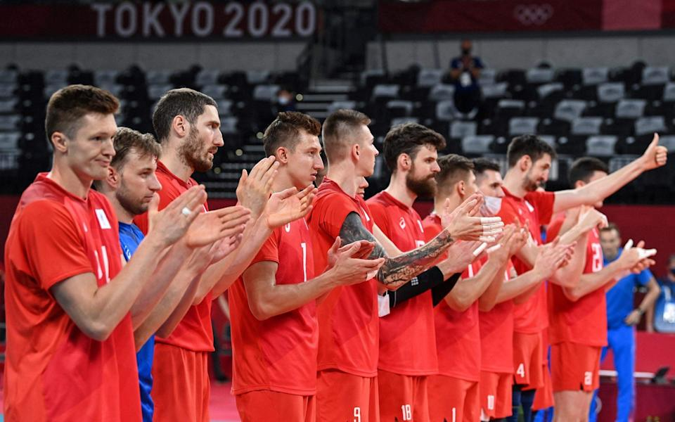 Russia's players applaud after their victory in the men's preliminary round pool B volleyball match between USA and Russia - Gigantic Russian presence at Tokyo Olympics makes mockery of Wada's doping ban