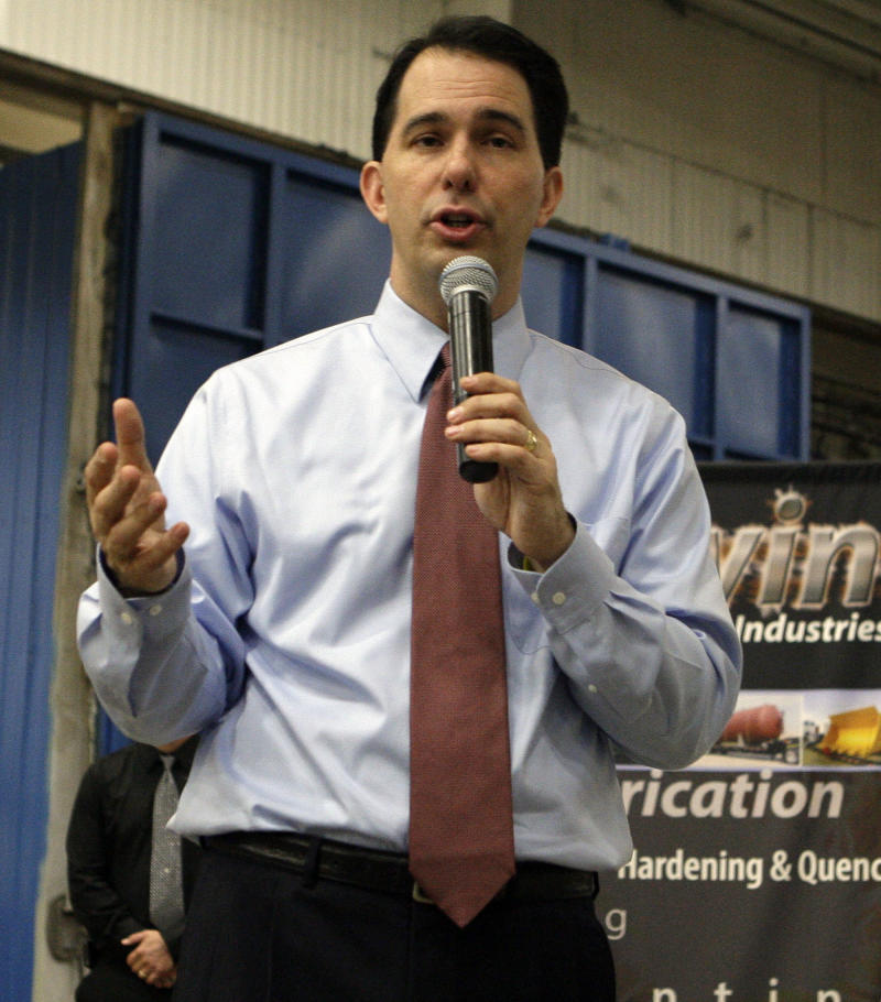 Gov. Scott Walker talks to employees at Steelwind Industries in Oak Creek, Wis. on Wednesday, June 6, 2012.  Walker won a contentious recall election against Milwaukee Mayor Tom Barrett. The recall capped a bitter fight between Walker supporters and public sector unions and labor groups angered by cuts to collective bargaining that the governor advanced.(AP Photo/Milwaukee Journal-Sentinel, John Klein)