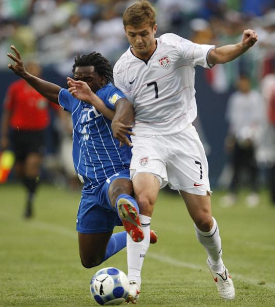 FILE- In this July 23, 2009 file photo, Honduras' Walter Martinez, left, strips the ball from United States' Robbie Rogers during the first half of a CONCACAF Gold Cup semifinal soccer game in Chicago. The Galaxy traded Mike Magee to his hometown Fire in exchange for the rights to Rogers, who will wear No. 14. If put on the field, as expected, Rogers will become the first openly gay athlete to play in a men's North American professional sports league Sunday, May 26, 2013. (AP Photo/Nam Y. Huh, File)