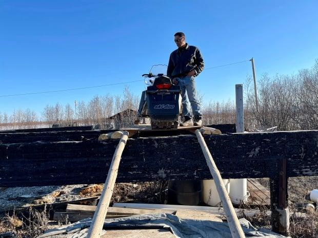 Allen Kogiak, of Aklavik, raised his skidoo to protect it from possible flooding.