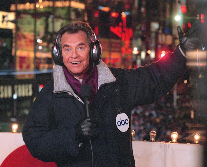 """FILE - In this undated file photo released by ABC, Dick Clark hosts the New Year's eve special from New York's Times Square. Clark, the television host who helped bring rock `n' roll into the mainstream on """"American Bandstand,"""" has died. He was 82. Spokesman Paul Shefrin says Clark died but did not provide further details. Clark had continued performing even after he suffered a stroke in 2004 that affected his ability to speak and walk.  (AP Photo/ABC, Donna Svennevik, File)"""