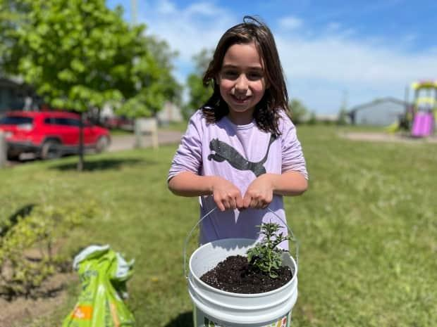 Gia McCormick says she will be back to check on some of the plants she put in the community garden, and might even take a few veggies for herself.