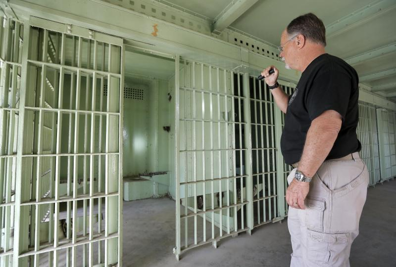 Retired Phoenix Police Sgt. Steve Proctor shows the jail cell, Wednesday, March 13, 2013 at the Phoenix Police Museum in Phoenix, where Ernesto Miranda was held 50 years ago today. The arrest of Miranda led to the landmark self-incrimination case that reached the Supreme Court and resulted in Miranda Rights that law enforcement uses when arresting a suspect. (AP Photo/Matt York)