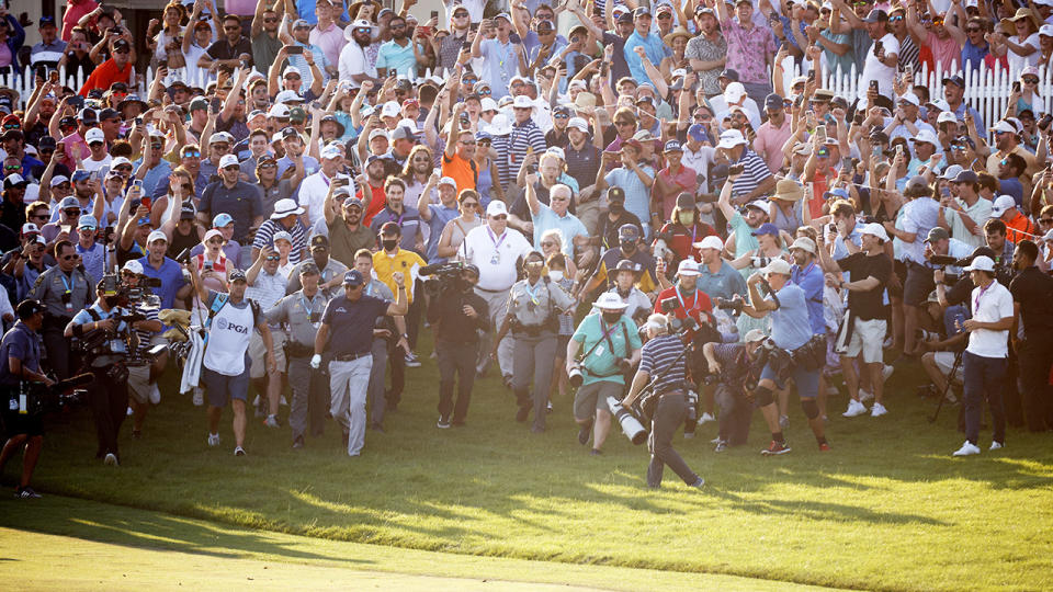 Thousands of fans, pictured here flooding the course as Phil Mickelson made his way to the 18th green.