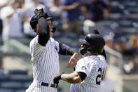 New York Yankees Aaron Judge, left, celebrates with Gary Sanchez (24) after scoring on Sanchez's sixth-inning, three-run home run in a baseball game against the Kansas City Royals, Thursday, June 24, 2021, at Yankee Stadium in New York. (AP Photo/Kathy Willens)