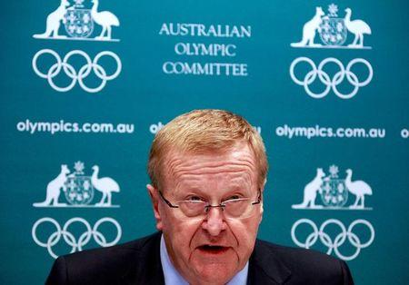 FILE PHOTO - John Coates reacts as he announces the findings of a probe into the conduct of Australian swimming team members in the run-up to the 2012 London Games, at a media conference in Sydney