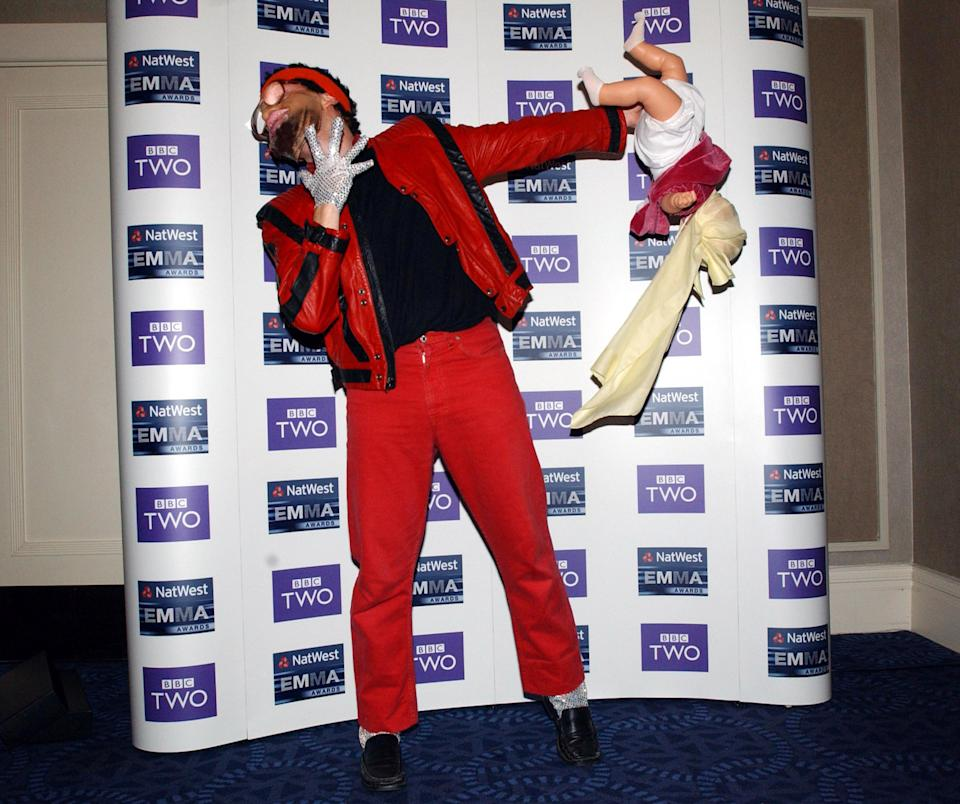 Comedian Avid Merrion, star of Channel 4's Bo Selecta, impersonates Michael Jackson during the 2003 NatWest EMMA (Ethnic Multicultural Media Academy) Awards, held at the Grosvenor House Hotel on Park Lane, central London.   (Photo by Yui Mok - PA Images/PA Images via Getty Images)