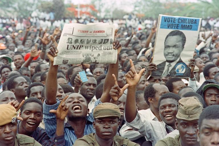 Supporters of Frederick Chiluba cheer his presidential inauguration in 1991, the first of two terms he would serve as Zambia's president