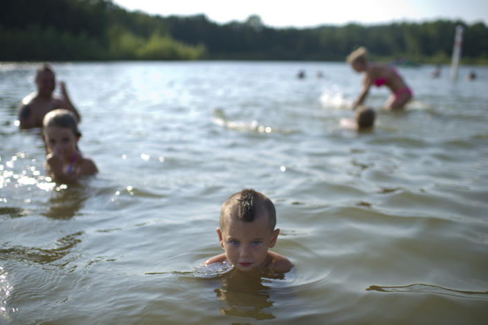 Parker Farrell, 2, cools off in the lake at Millenium Park in Grand Rapids, Mich., as temperatures rose to a high of 96 degrees on Thursday, June 28, 2012. (AP Photo/The Grand Rapids Press, Matthew Busch)