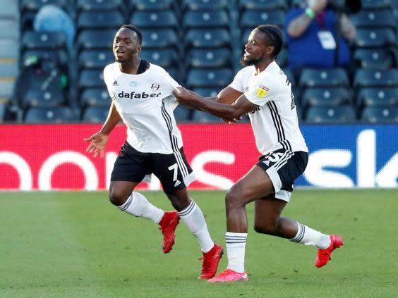 Fulham's Neeskens Kebano, left, celebrates scoring their first goal (Reuters)