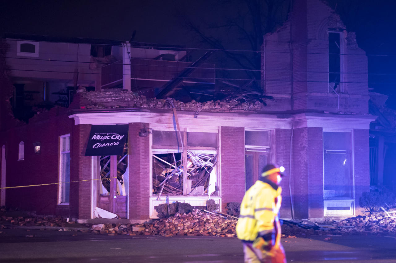 Emergency crews work near a damaged business at Jefferson St. and Seventh Ave. N. on March 3, 2020 in Nashville, Tennessee. A tornado passed through Nashville just after midnight leaving a wake of damage in its path. (Brett Carlsen/Getty Images)