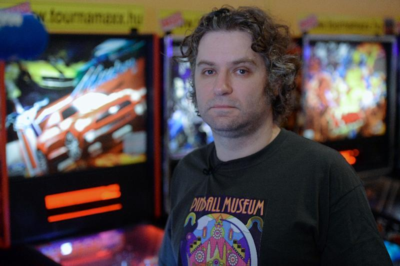 Owner of the 'Pinball Museum', collector Balazs Palfi, in Budapest on March 14, 2015 (AFP Photo/Attila Kisbenedek)