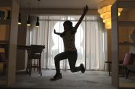 Michelle Rasul jumps around in the lobby of her apartment building in Dubai, United Arab Emirates, Sunday, May 9, 2021. Rasul, a 9-year-old girl from Azerbaijan who lives in Dubai, is scratching her way to the top as a DJ after competing in the DMC World DJ Championship. (AP Photo/Kamran Jebreili)