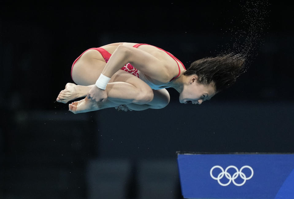 Chen Yuxi of China competes in women's diving 10m platform final at the Tokyo Aquatics Centre at the 2020 Summer Olympics, Thursday, Aug. 5, 2021, in Tokyo, Japan. (AP Photo/Dmitri Lovetsky)