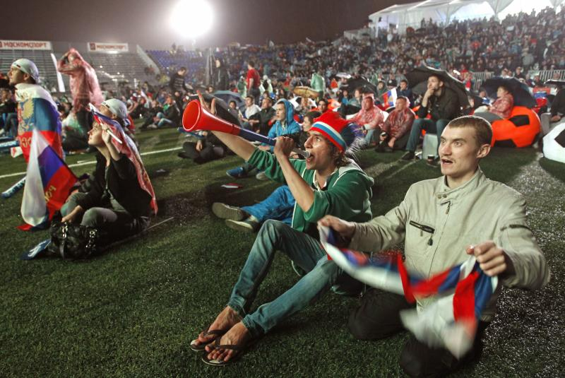 Russian soccer fans react as watch of the Euro 2012 soccer championship Group A match between Russia and Czech Republic on the screen at the Luzhniki stadium in Moscow, Russia, Friday, June 8, 2012. (AP Photo/Mikhail Metzel)