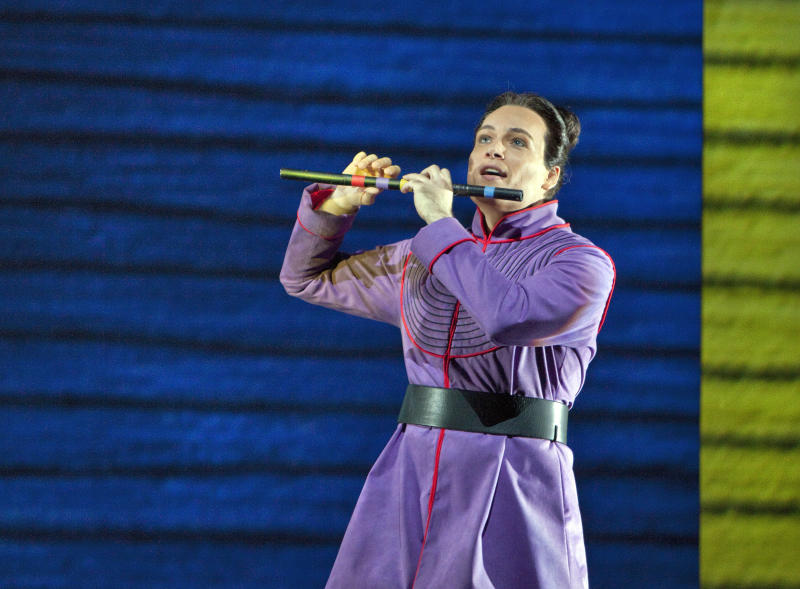 "In this June 10, 2012 handout photo provided by the San Francisco Opera, Alek Shrader as Tamino is shown during a scene from the final dress rehearsal of ""The Magic Flute."" The San Francisco Opera's summer season includes  a musically rousing rendition of Verdi's ""Attila,"" and a visually captivating take on Mozart's ""The Magic Flute.""  (AP Photo/San Francisco Opera, Cory Weaver)"